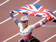 Great Britain's Hannah Cockroft celebrates winning the Women's 100 metres – T34 final at the Olympic Stadium during day five of the Tokyo 2020 Paralympic Games in Japan (Tim Goode/PA)