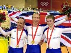 Great Britain's Jamie Staff (left), Sir Chris Hoy and Jason Kenny (right) celebrate their gold medal in the team sprint event at the 2008 Beijing Olympics (John Giles/PA)