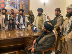 Taliban fighters take control of Afghan presidential palace after the Afghan President Ashraf Ghani fled the country, in Kabul, Afghanistan (Zabi Karimi/AP)