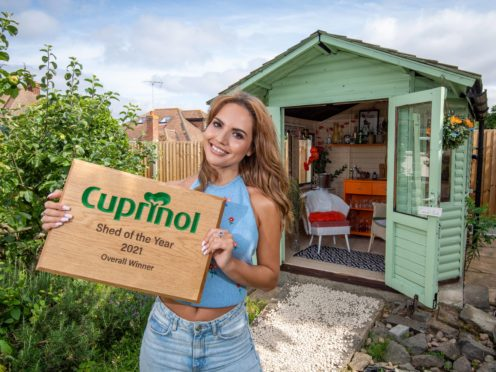 Cuprinol Shed of the Year winner Danielle Zarb-Cousin with her 70s-inspired cocktail bar (Cuprinol Shed of the Year/PA)
