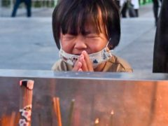 A child prays in front of the cenotaph dedicated to the victims of the atomic bombing at the Hiroshima Peace Memorial Park (Kyodo/AP)