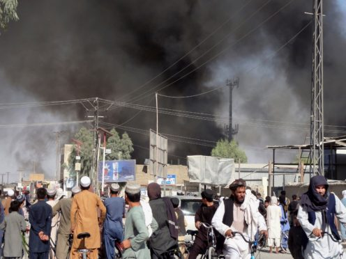 Smoke rises after fighting between the Taliban and Afghan security personnel in the city of Kandahar, southwest of Kabul, Afghanistan (Sidiqullah Khan/AP)