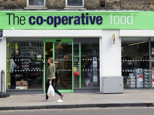 The Co-op has warned over food price hikes and pressure on its annual profits from the mounting supply chain crisis as it swung to a half-year loss (Yui Mok/PA)