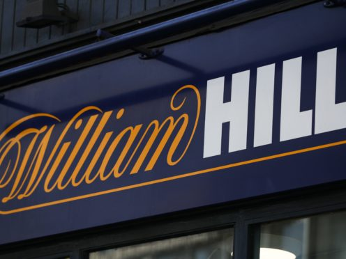 Online gambling group 888 has agreed a £2.2bn deal to buy William Hill's European business and its 1,400 UK betting shops in a move that will see it return to British hands (Aaron Chown/PA)