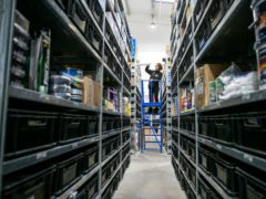 Ulla Sandells serves customers at Toolstation in Bristol (Adam Gasson/PA)