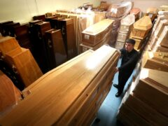 Empty coffins in a storage room at a Glasgow funeral home during the pandemic (Andrew Milligan/PA)