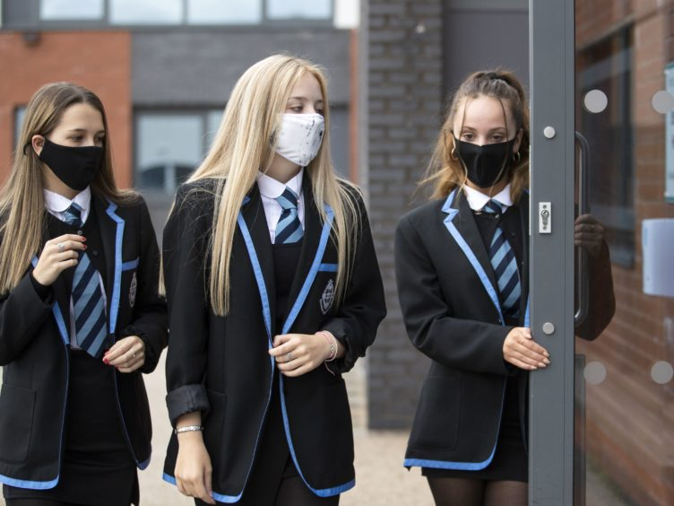 Face coverings and other Covid mitigations are to remain in schools until at least the October holidays, Nicola Sturgeon has said (Jane Barlow/PA)