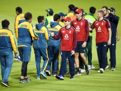 Pakistan and England players shake hands at the end of play during the third Vitality IT20 match at Old Trafford, Manchester.