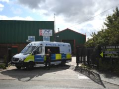 Police at Albion Works industrial estate in Brierley Hill, West Midlands, after the double shooting (Joe Giddens/PA)