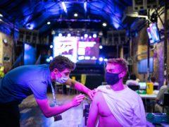 Chris Jordan receives a dose of coronavirus vaccine at a nightclub in central London (PA)