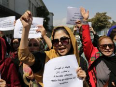 Women gather to demand their rights under the Taliban rule during a protest in Kabul (AP)