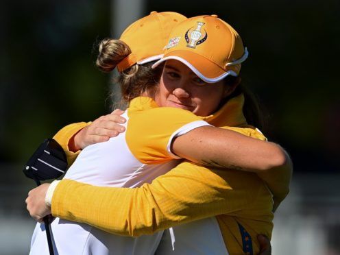 Leona Maguire (right) and Mel Reid celebrate their win against the USA in Sunday's foursomes in the 17th Solheim Cup (David Dermer/AP)