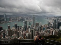 A visitor sets up his camera in the Victoria Peak area to photograph Hong Kong's skyline (Jae C. Hong/AP)