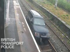 Aaron O'Halloran driving a car on railway tracks between Duddeston and Aston stations in Birmingham (BTP/PA)