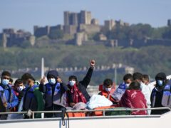 A group of people thought to be migrants are brought in to Dover, Kent, aboard a Border Force vessel following a small boat incident in the Channel (Steve Parsons/PA)