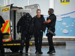 Armed police detain a man (centre) at the scene of an incident in Hengrove Way, Bristol (Ben Birchall/PA)