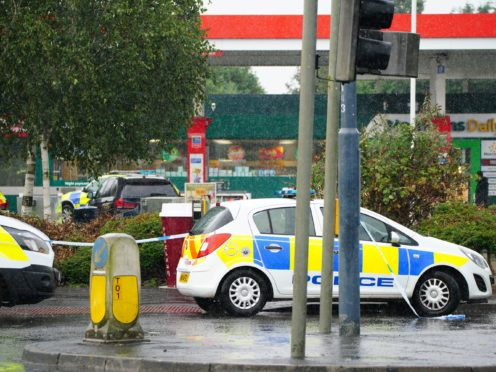 Police at the scene of an incident in Hengrove Way (PA)