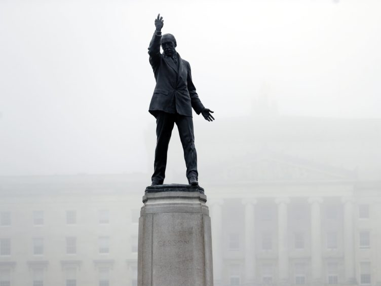 A blanket of fog descends on Parliament Buildings in Stormont, Belfast. The Democratic Unionist Party leader Jeffrey Donaldson threatened to collapse Stormont in weeks over the Northern Ireland Protocol. (Peter Morrison/PA)