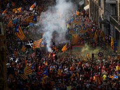 Demonstrators march during the Catalan National Day in Barcelona (AP)