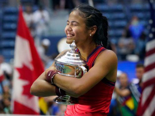 Emma Raducanu hugs the trophy (Elise Amendola/AP)