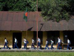Students arrive at the Narinda Government High School (Mahmud Hossain Opu/AP)