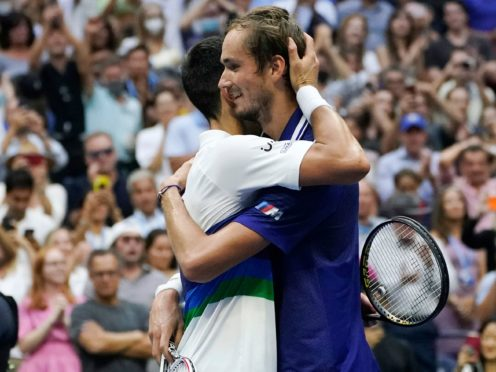 Daniil Medvedev, right, hugs Novak Djokovic at the end of the US Open final (Elise Amendola/AP)