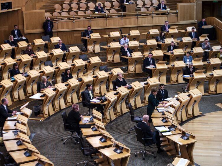 MSPs have backed the proposal to double the unpaid carers allowance this December (Andy Buchanan/PA)