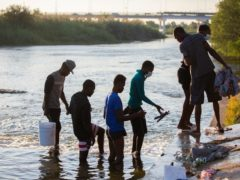 Haitian migrants part of the group of people from Haiti waiting in Del Rio and Ciudad Acuna to get access to the United States cross the Rio Grande (Marie D De Jesus/AP)