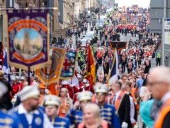 Members of the County Grand Orange Lodge take part in the annual Orange walk parade through the city centre of Glasgow (Robert Perry/PA)