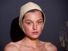 Emma Corrin traded her crown for a bonnet at an Emmys red carpet (Joel C Ryan/Invision/AP)