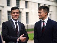 Afghan special operations officer First Lieutenant Mohammad Jawad Akbari, left, and British Army officer Captain Dave Kellett talk to each other by the Iraq Afghanistan Memorial at the Ministry of Defence building in Westminster, central London (Victoria Jones/PA)