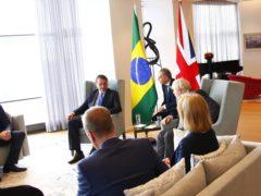 Boris Johnson (centre) with Brazil's president Jair Bolsonaro (second left) (Michael M. Santiago/PA)
