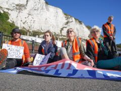 Protesters from Insulate Britain block the A20 in Kent, which provides access to the Port of Dover (Gareth Fuller/PA)