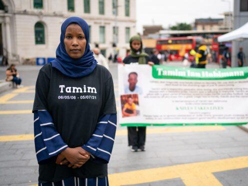 Hawa Haragakiza attends a vigil in Woolwich (Dominic Lipinski/PA)