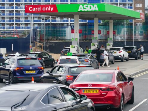 Cars queue for fuel at an Asda petrol station in south London (Dominic Lipinski/PA)