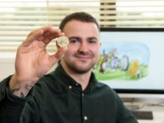 Royal Mint designer Daniel Thorne with the new Winnie-the-Pooh and Friends 50p coin (Royal Mint/PA)