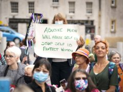 Opponents of plans to reform the legislation on gender recognition gathered outside Holyrood (Jane Barlow/PA)