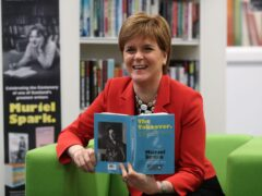 First Minister Nicola Sturgeon holds a book by Muriel Spark during a library visit (Andrew Milligan/PA)