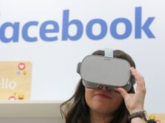 A woman uses an Oculus virtual reality headset at the Facebook stand during the Dublin Tech Summit (Niall Carson/PA)