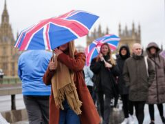 People walk across London's Westminster Bridge, as the Met Office issued weather warnings (Kirsty O'Connor/PA)