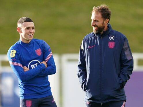 England manager Gareth Southgate (right) is eager not to put too much pressure on Phil Foden (Nick Potts/PA).