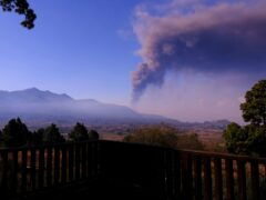 Smoke rises on the horizon as lava flows from a volcano on the Canary island of La Palma, Spain (Daniel Roca/AP)