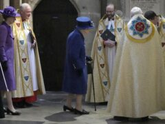 The Queen arrives to attend a Service of Thanksgiving at Westminster Abbey in London to mark the centenary of the Royal British Legion (Frank Augstein/PA)