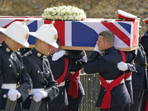 The coffin of Major General Matthew Holmes, former head of the Royal Marines, is carried into Winchester Cathedral (Andrew Matthews/PA)