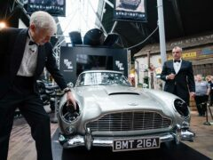Lord Montagu of Beaulieu, left, and special effects supervisor Chris Corbould with the Aston Martin DB5 (Andrew Matthews/PA)