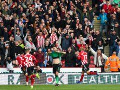 Sheffield United's David McGoldrick (right) celebrates scoring the winning goal against Stoke (Isaac Parkin/PA)