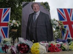 People from the UK Iranian community hold a vigil for Sir David Amess in Parliament Square (Victoria Jones/PA)