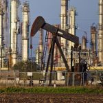 Oil trades near $50 after decline in US drilling
