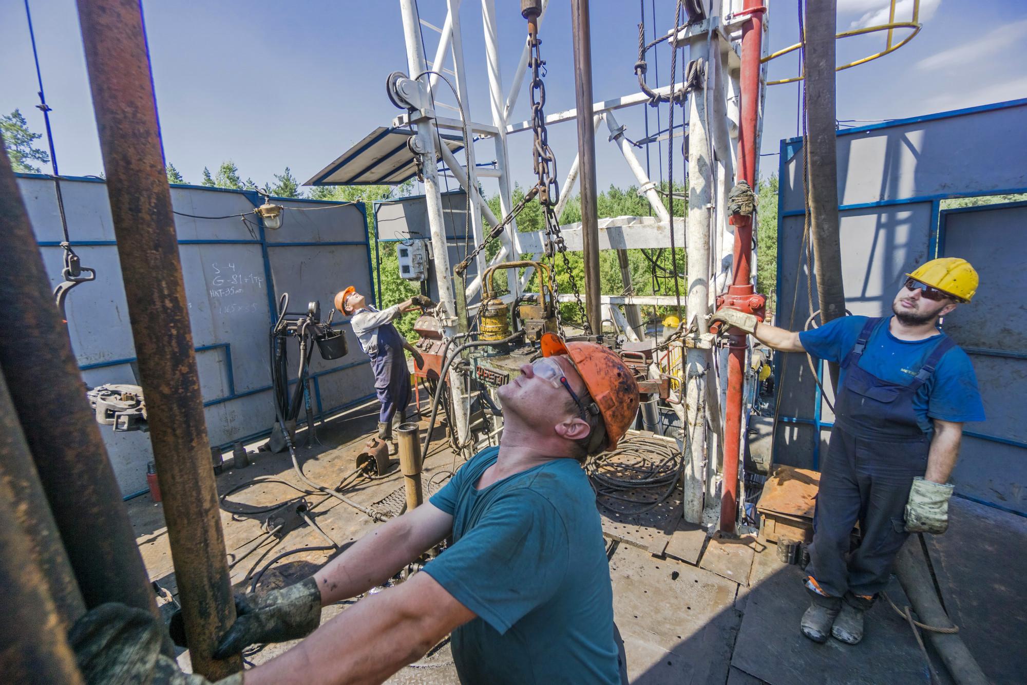 Oil holds below $65 after volatile week of pipeline woes