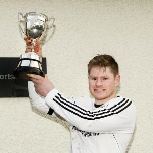 Lovat captain Drew Howie holds aloft the Lovat Cup. Photograph: Neil Paterson.